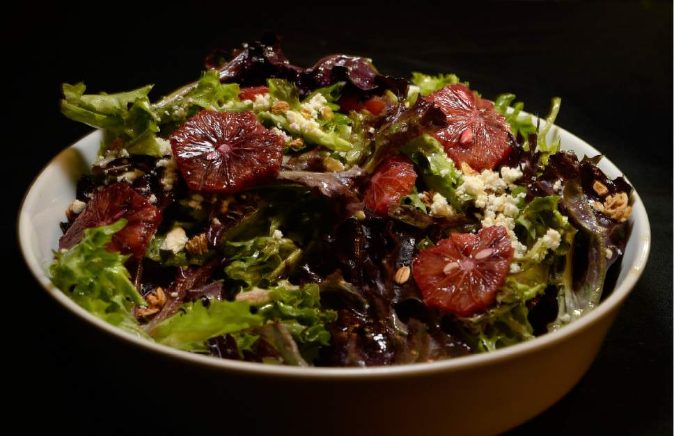 Scott Sommerdorf | The Salt Lake Tribune The blood orange salad at the Charleston Cafe in Draper. Housed in an historic home in Draper, Charleston Cafe serves up salads and paninis at lunch while dinner delivers smoked meats and high-end cuisine that will surprise and delight.