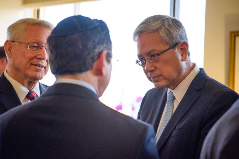 Photo courtesy LDS Church Elder Gerrit W. Gong of the Presidency of the Seventy talks with Rabbi Gideon Shloush, Congregation Adereth El and Bishop Dean M. Davies, first counselor in the Presiding Bishopric of the Church.