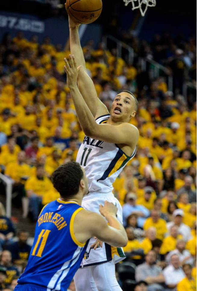 Steve Griffin  |  The Salt Lake Tribune   Utah Jazz guard Dante Exum (11) shoots over Golden State Warriors guard Klay Thompson (11) during game 4 of the NBA playoff game between the Utah Jazz and the Golden State Warriors at Vivint Smart Home Arena in Salt Lake City Monday May 8, 2017.