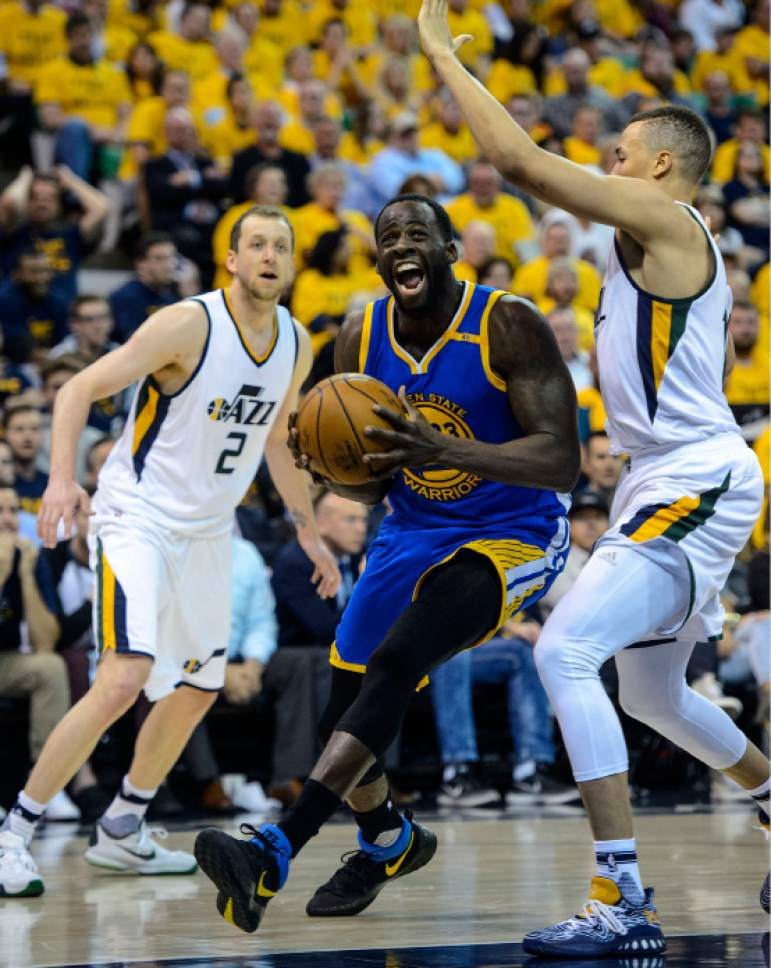 Steve Griffin  |  The Salt Lake Tribune   Golden State Warriors forward Draymond Green (23) powers his way past Utah Jazz guard Dante Exum (11) during game 4 of the NBA playoff game between the Utah Jazz and the Golden State Warriors at Vivint Smart Home Arena in Salt Lake City Monday May 8, 2017.