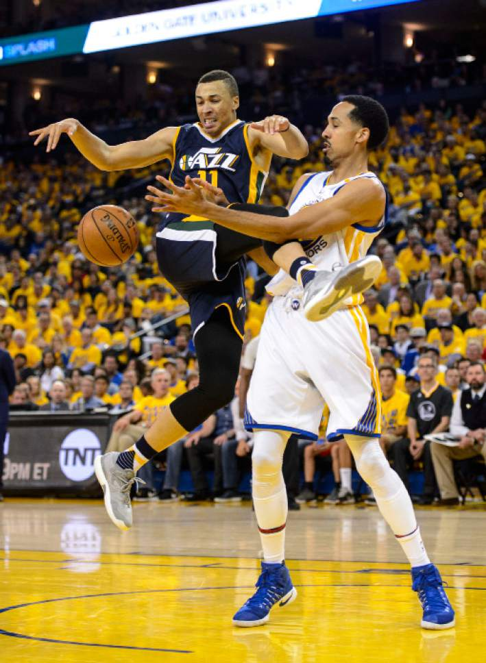 Steve Griffin  |  The Salt Lake Tribune   Utah Jazz guard Dante Exum (11) gets fouled by Golden State Warriors guard Shaun Livingston (34) during game 2 of the NBA playoff game between the Utah Jazz and the Golden State Warriors at Oracle Arena in Oakland Thursday May 4, 2017.