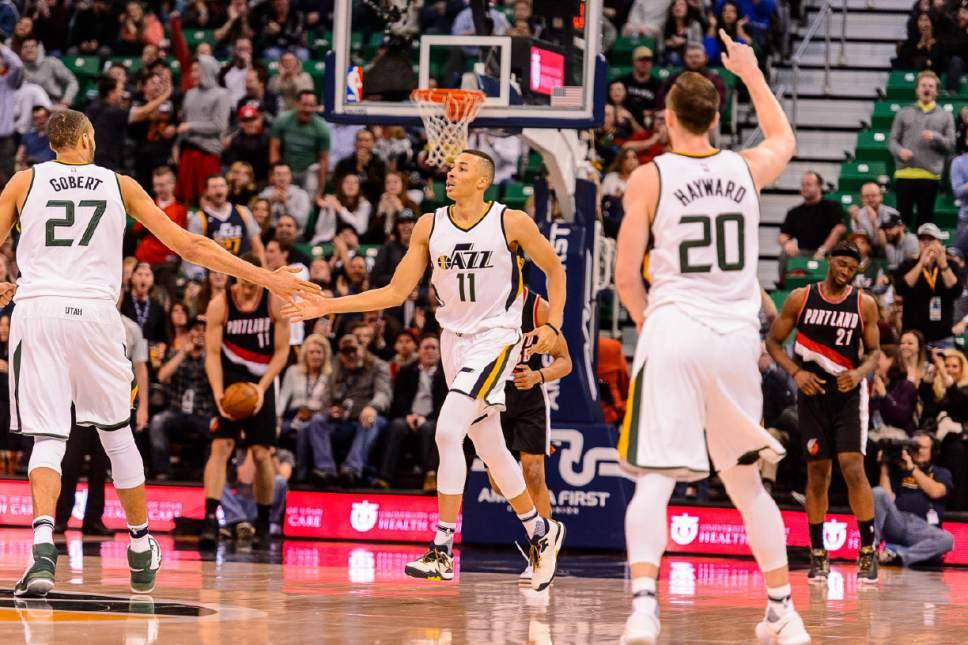 Trent Nelson  |  The Salt Lake Tribune Utah Jazz guard Dante Exum (11) high-fives Utah Jazz center Rudy Gobert (27) after dunking the ball in the 4th quarter, as the Utah Jazz host the Portland Trailblazers, NBA basketball in Salt Lake City, Wednesday February 15, 2017.