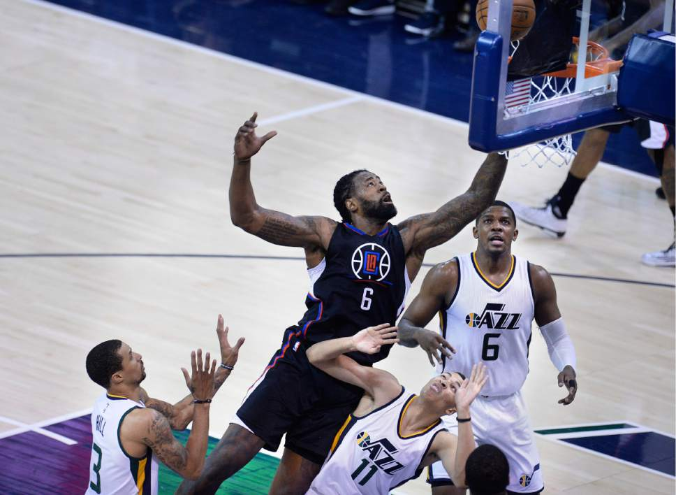 Scott Sommerdorf | The Salt Lake Tribune LA Clippers center DeAndre Jordan (6) drives to the hoop over Utah Jazz guard Dante Exum (11) during second half play. The Utah Jazz beat the LA Clipper 105-98 to take Game 4 and tie up the Western Conference playoff series at 2-2, Sunday, April 23, 2017.