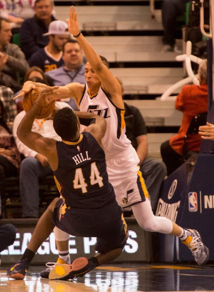 Rick Egan  |  The Salt Lake Tribune  Utah Jazz guard Dante Exum (11) is called for a foul, as New Orleans Pelicans forward Solomon Hill (44) slides into him, in NBA action Utah Jazz vs. New Orleans Pelicans, in Salt Lake City, Monday, March 27, 2017.