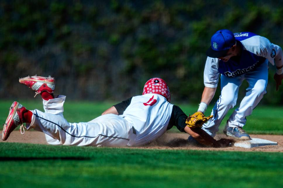 Chris Detrick  |  The Salt Lake Tribune Grand County's Brayden Schultz (6) dives safely back to second base past Gunnison Valley's Parx Bartholomew (3) during the Class 2A baseball state semifinal game at Kearns High School Friday, May 12, 2017.