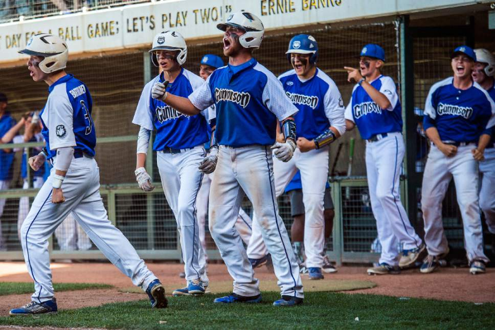 Chris Detrick  |  The Salt Lake Tribune Gunnison Valley's Drew Hill (2), center, cheers as Jaden Mayne (12) scores a run during the Class 2A baseball state semifinal game at Kearns High School Friday, May 12, 2017.
