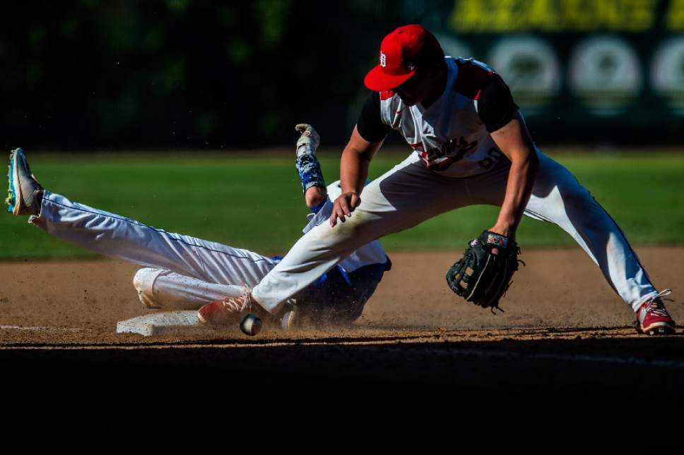 Chris Detrick  |  The Salt Lake Tribune Gunnison Valley's Mason Bartholomew (14) slides safely into third base past Grand County's Christian Wilson (28)  during the Class 2A baseball state semifinal game at Kearns High School Friday, May 12, 2017.