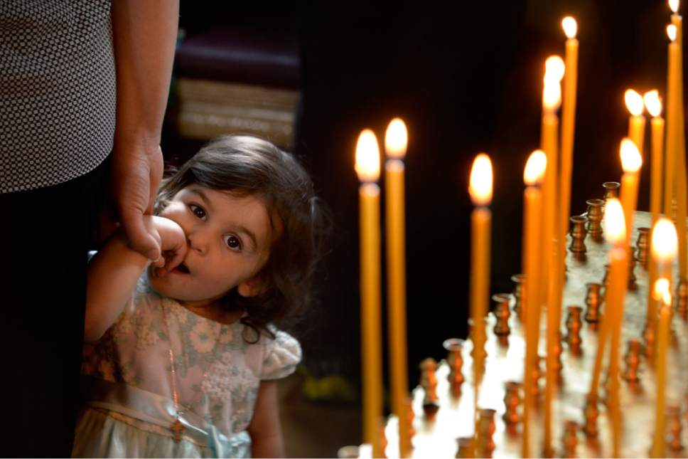 Scott Sommerdorf   The Salt Lake Tribune A young girl carefully watches a visitor during worship service at Sts. Peter and Paul Orthodox Christian Church, Sunday, April 30, 2017.