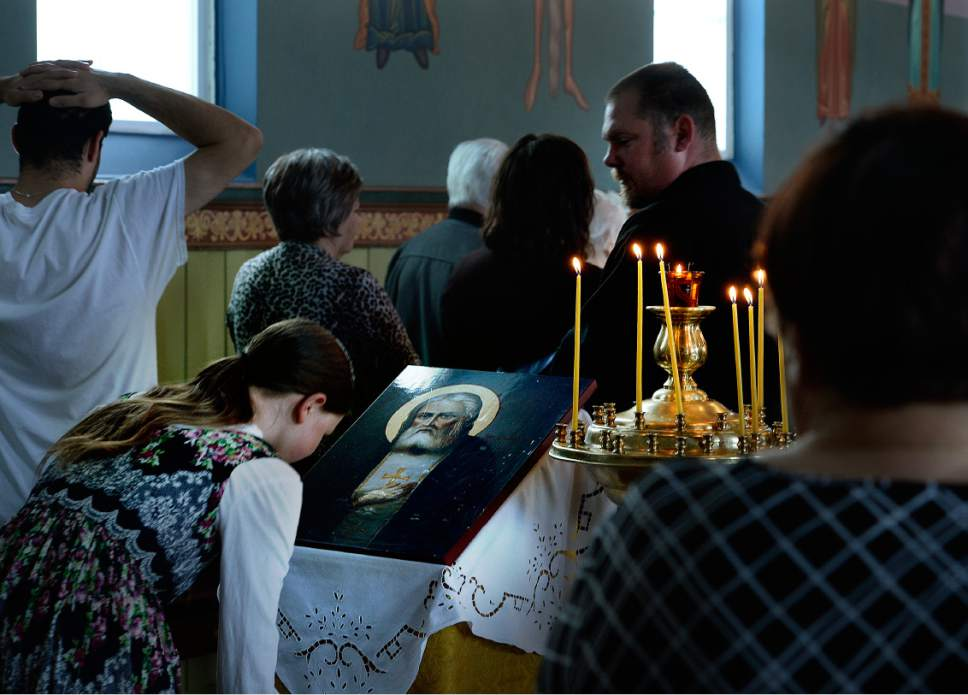 Scott Sommerdorf   The Salt Lake Tribune A young woman bows and kisses an icon during worship service at Sts. Peter and Paul Orthodox Christian Church, Sunday, April 30, 2017.