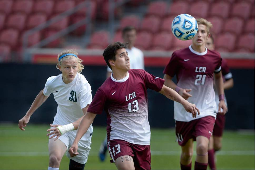 Scott Sommerdorf | The Salt Lake Tribune Georgi Cole, left, of South Summit, and Jesus Tomasi battle for a loose ball during first half play. Layton Christian Academy beat South Summit 1-0 to win the 2A championship at Rio Tinto Stadium, Saturday, May 13, 2017.