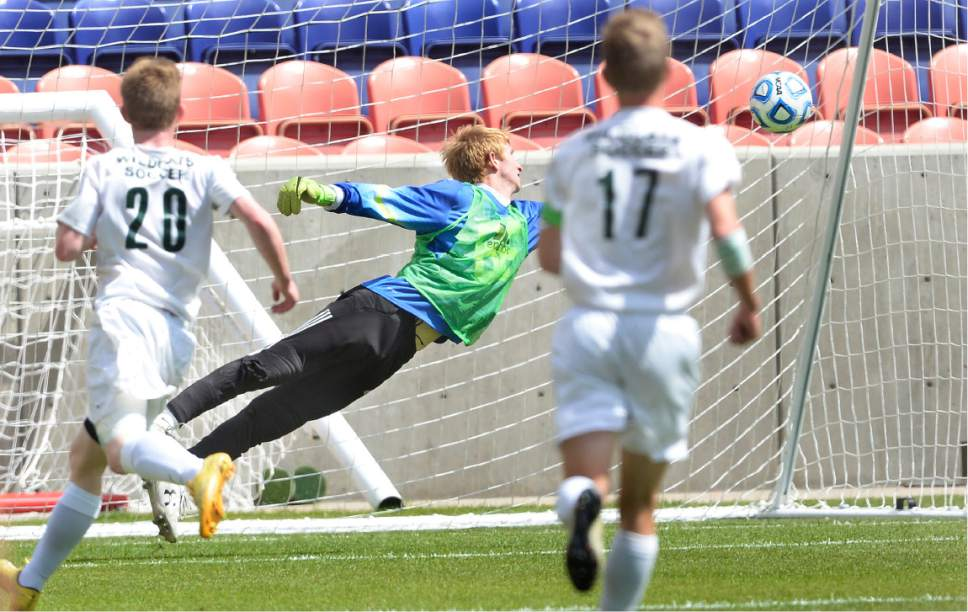 Scott Sommerdorf | The Salt Lake Tribune South Summit goalkeeper Nick Beasley can't get to this goal by Layton Christian Academy's Ryan Arevalo to give LCA the lead at 1-0. Layton Christian Academy made the goal stand up with great defense as they beat South Summit 1-0 to win the 2A championship at Rio Tinto Stadium, Saturday, May 13, 2017.