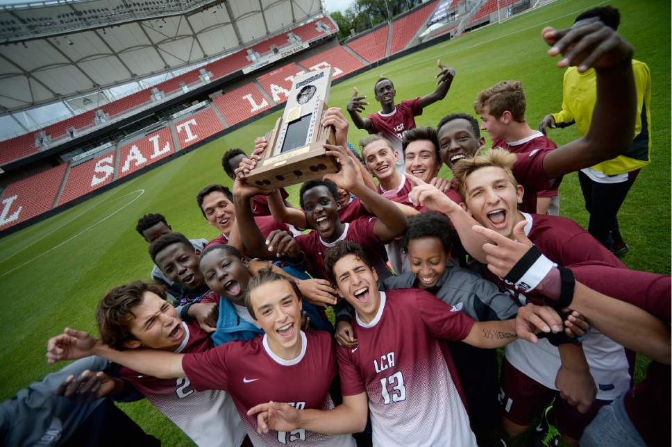 Scott Sommerdorf | The Salt Lake Tribune Layton Christian Academy celebrates their 2A trophy after beating South Summit 1-0 to win the championship at Rio Tinto Stadium, Saturday, May 13, 2017.