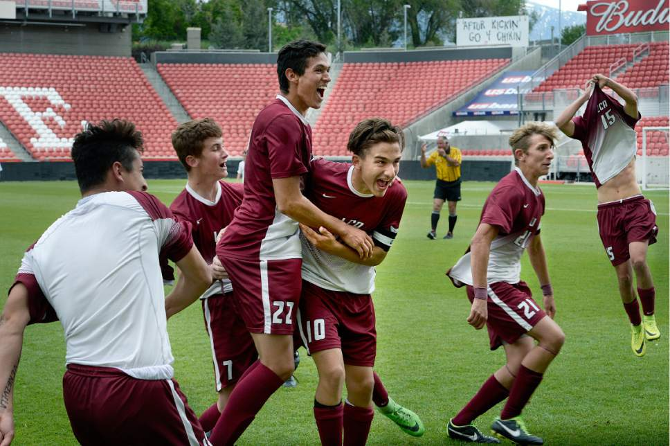 Scott Sommerdorf | The Salt Lake Tribune Layton Christian Academy celebrates their win after beating South Summit 1-0 to win the 2A championship at Rio Tinto Stadium, Saturday, May 13, 2017.