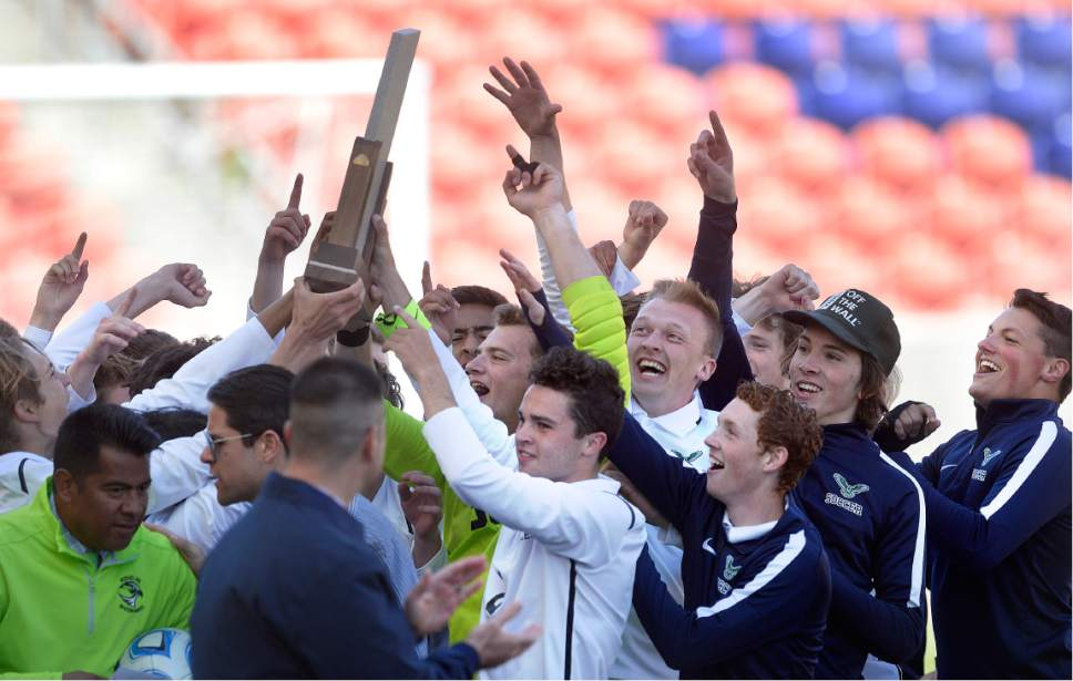 Scott Sommerdorf | The Salt Lake Tribune Ridgeline celebrates after they beat Juan Diego 2-1 in 2 OT to win the 3A state soccer championship, Saturday, May 13, 2017.
