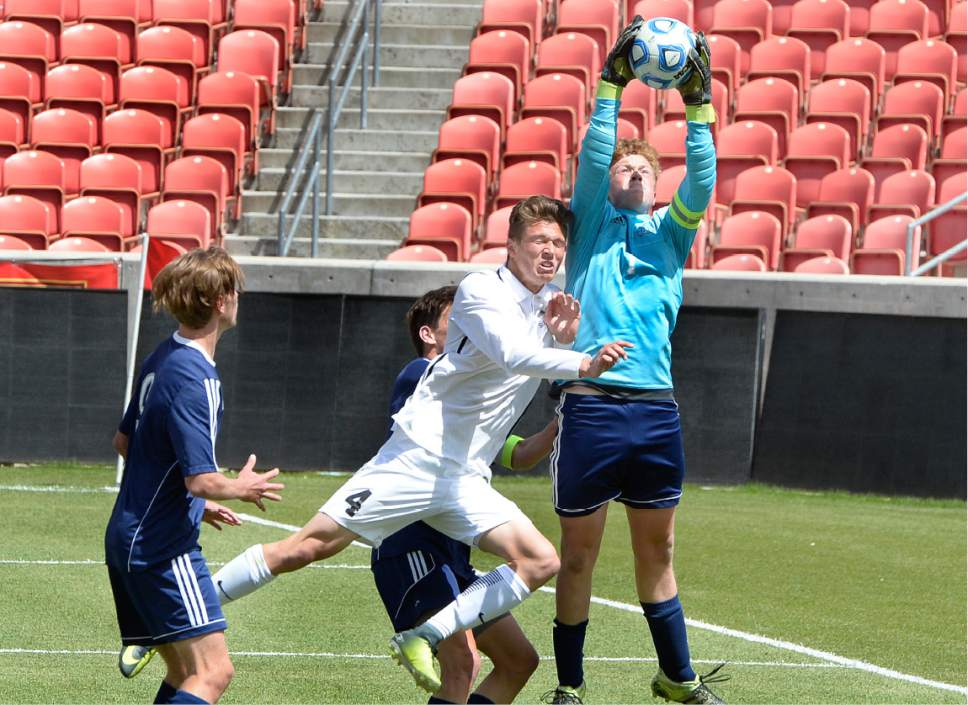 Scott Sommerdorf | The Salt Lake Tribune Juan Diego goalkeeper Martin Kelly makes this save against the pressure from Ridgeline's Benson Hill during second half play. Ridgeline beat Juan Diego 2-1 in 2 OT to win the 3A state soccer championship, Saturday, May 13, 2017.