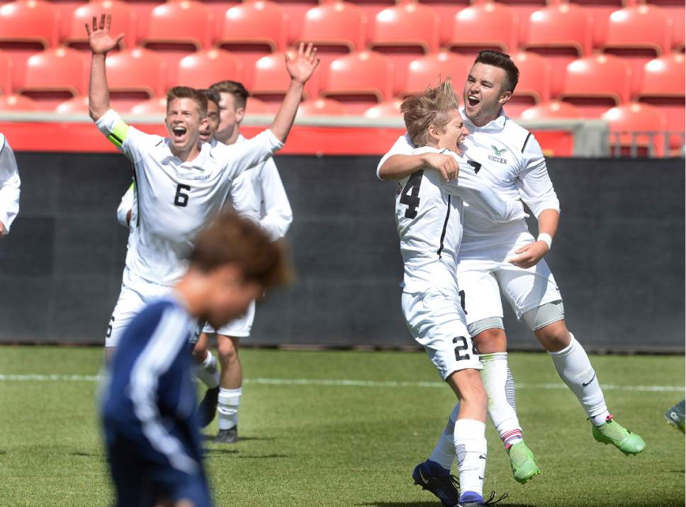 Scott Sommerdorf | The Salt Lake Tribune Alex Cruz, right, celebrates his golden goal to win the game and 3A championship for Ridgeline as they beat Juan Diego 2-1 in 2 OT, Saturday, May 13, 2017.