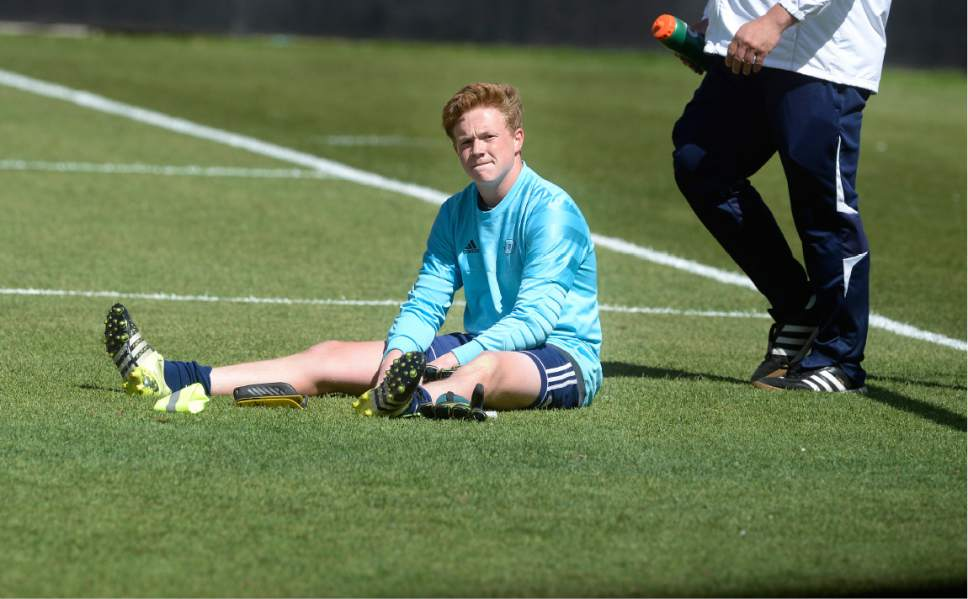 Scott Sommerdorf | The Salt Lake Tribune Juan Diego goalkeeper sits dejectedly after he let in a goal by Alex Cruz in the second OT to give Ridgeline the win over Juan Diego 2-1, and the 3A state soccer championship, Saturday, May 13, 2017.