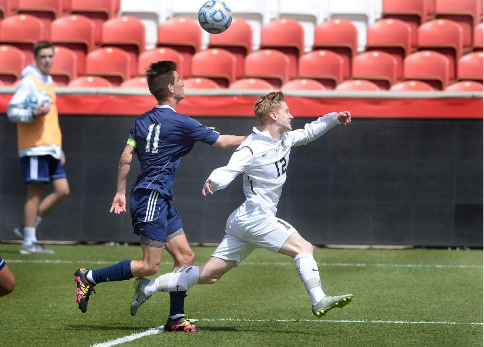 Scott Sommerdorf | The Salt Lake Tribune This push in the back to Ridgeline's Andy Paine just inside the box gave Ridgeline a penalty shot, and the equalizer for a 1-1 tie. Ridgeline went on to beat Juan Diego 2-1 in 2 OT to win the 3A state soccer championship, Saturday, May 13, 2017.