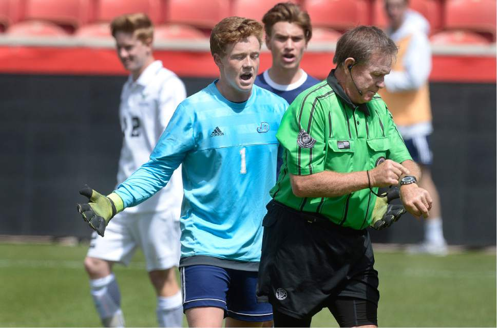 Scott Sommerdorf | The Salt Lake Tribune Juan Diego's goalkeeper Martin Kelly argues the penalty shot call against Reggie Anderson with the referee. Ridgeline beat Juan Diego 2-1 in 2 OT to win the 3A state soccer championship, Saturday, May 13, 2017.