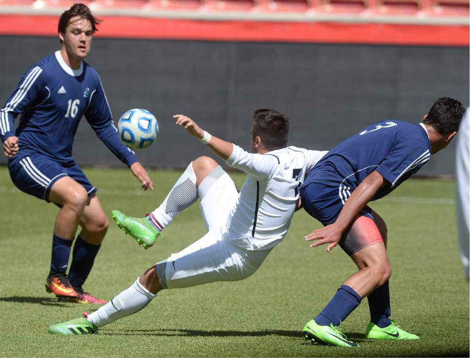 Scott Sommerdorf | The Salt Lake Tribune Juan Diego's Akex Saunders gets to this ball after Ridgeline's Alex Cruz falls during second half play. Ridgeline beat Juan Diego 2-1 in 2 OT on Cruz's golden goal to win the 3A state soccer championship, Saturday, May 13, 2017.