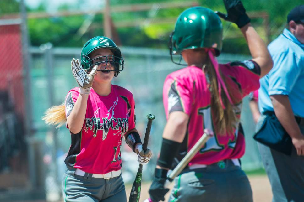 Chris Detrick  |  The Salt Lake Tribune South Summit's Grace Olson (11) and South Summit's Cassidy Hortin (15) celebrate a run during the Class 2A state softball title game at Spanish Fork Complex Saturday, May 13, 2017.