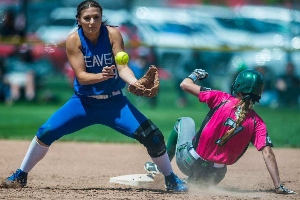 Chris Detrick  |  The Salt Lake Tribune South Summit's Abcdee Berg (7) slides safely into second base past Beaver's Abbey Yardley (7) during the Class 2A state softball title game at Spanish Fork Complex Saturday, May 13, 2017.