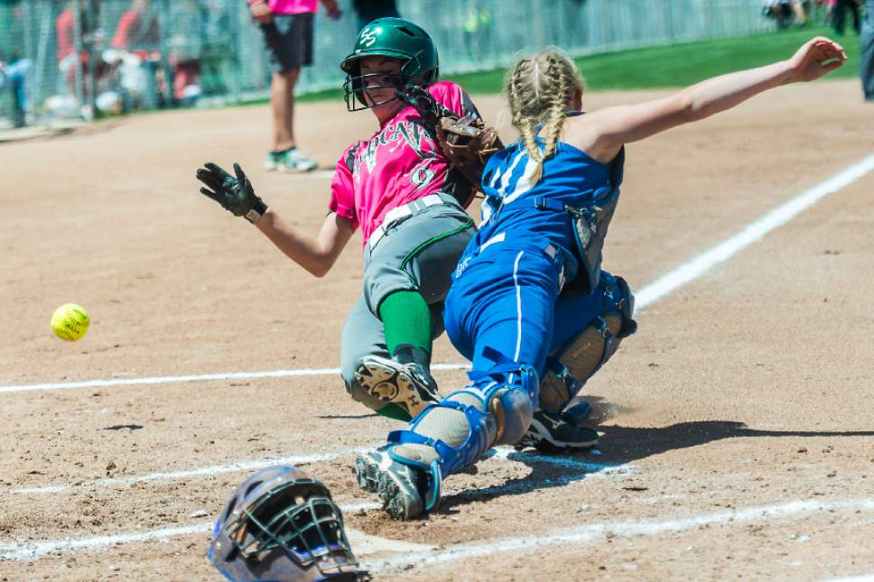 Chris Detrick  |  The Salt Lake Tribune South Summit's Alayna Hansen (9) slides safely into home past Beaver's Tavy Gale (10) during the Class 2A state softball title game at Spanish Fork Complex Saturday, May 13, 2017.