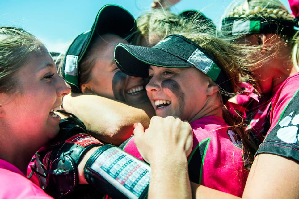 Chris Detrick  |  The Salt Lake Tribune Members of the South Summit softball team celebrate after wining the Class 2A state softball championship game at Spanish Fork Complex Saturday, May 13, 2017. South Summit defeated Beaver 9-1.