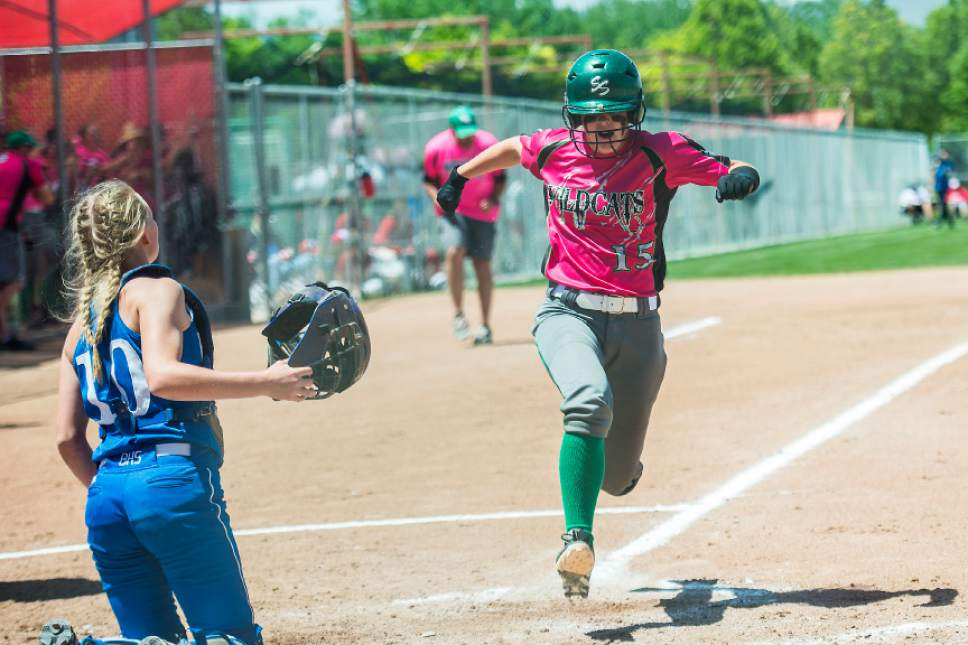 Chris Detrick  |  The Salt Lake Tribune South Summit's Cassidy Hortin (15) scores past Beaver's Tavy Gale (10) during the Class 2A state softball title game at Spanish Fork Complex Saturday, May 13, 2017.