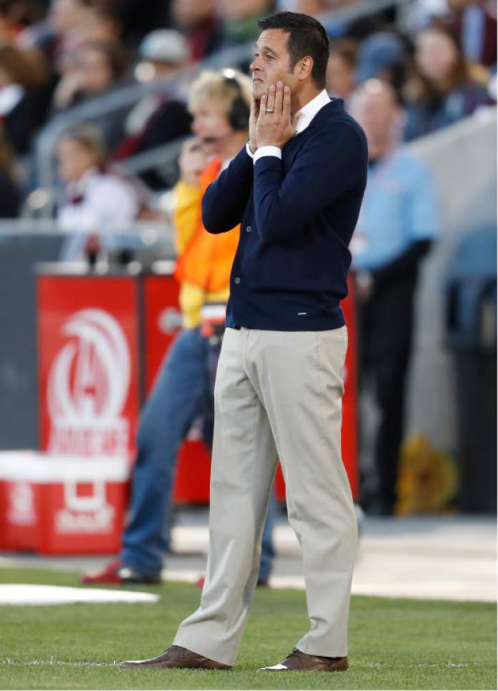 Real Salt Lake head coach Mike Petke looks on against the Colorado Rapids in the first half of an MLS soccer match, Saturday, April 15, 2017, in Commerce City, Colo. (AP Photo/David Zalubowski)
