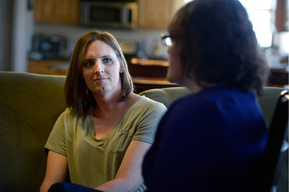 Scott Sommerdorf | The Salt Lake Tribune Ann Pack, a transgender woman, listens as her wife, Brigit, speaks about their lives and their relationships with their daughter.