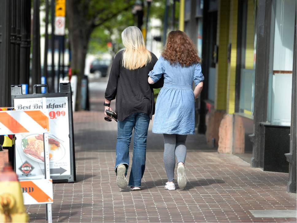 Scott Sommerdorf   The Salt Lake Tribune Sara Jade Woodhouse, left, and her daughter, Kira, leave a breakfast together arm in arm, Saturday, May 6, 2017.