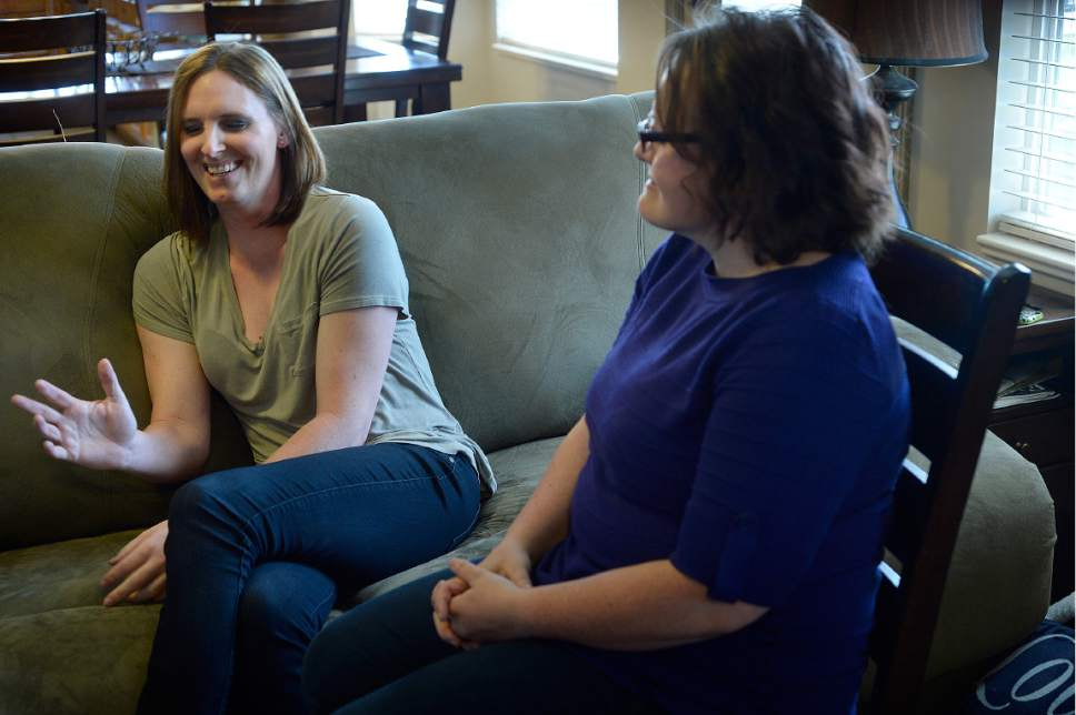 Scott Sommerdorf | The Salt Lake Tribune Ann Pack, a transgender woman, left, laughs as she and her wife, Brigit, talk about how their lives have changed, and their relationship since Ann's transition.