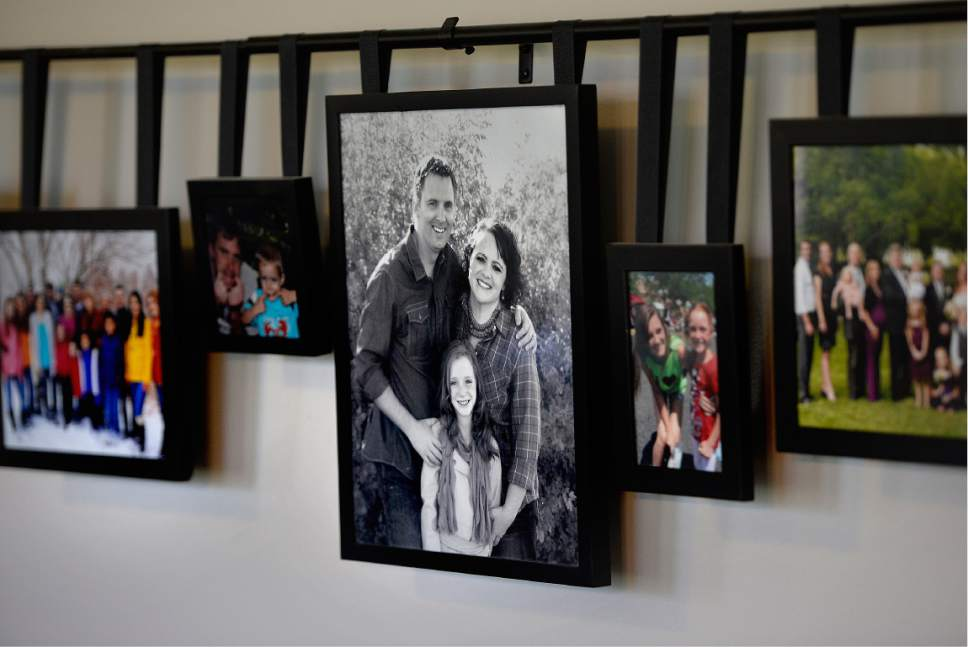 Scott Sommerdorf | The Salt Lake Tribune Familiy photos on the wall at the home of Ann Pack, a transgender woman, and her wif,e Brigit, Wednesday, May 3, 2017.