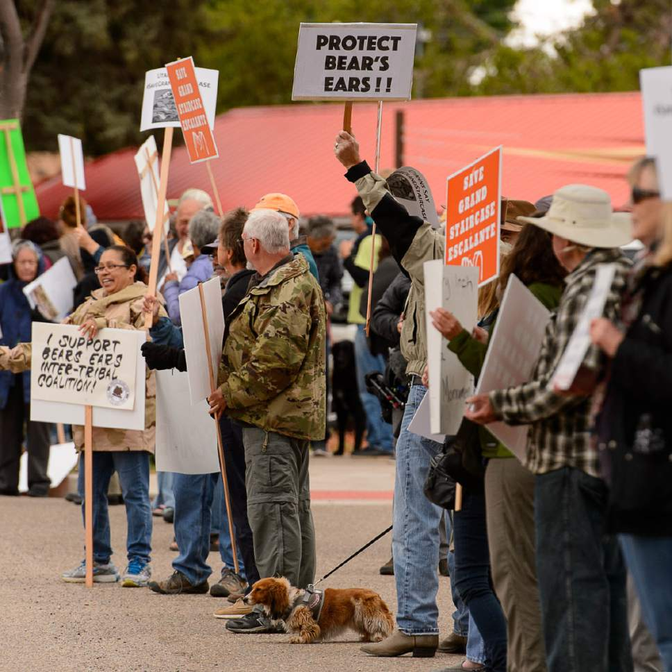 Trent Nelson  |  The Salt Lake Tribune People hold signs up for passing cars at a Monument Rally and Business Owner's Press Conference in Kanab, Wednesday May 10, 2017. The event was planned to occur in conjunction with Interior Secretary Ryan Zinke's visit to Grand Staircase-Escalante National Monument.
