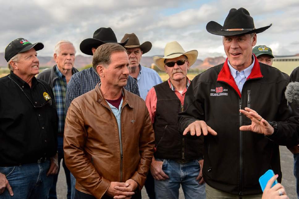 Trent Nelson  |  The Salt Lake Tribune Secretary of the Interior Ryan Zinke, right, speaks at a news conference at the Kanab Airport, Wednesday May 10, 2017. Standing with him were Rep. Chris Stewart and a group of county commissioners.