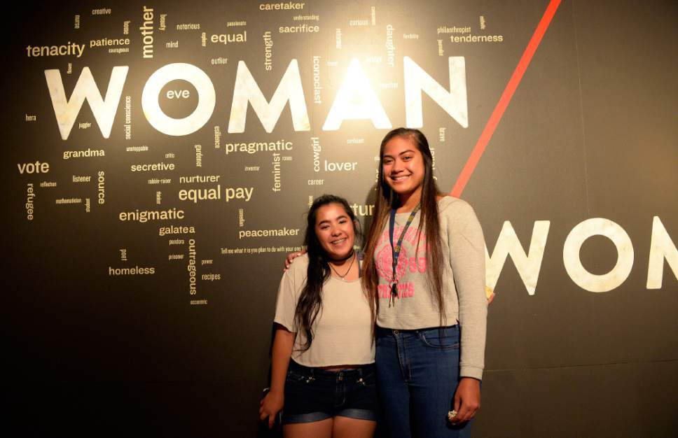 "Al Hartmann  |  The Salt Lake TrAlibune The Leonardo is unveiling a new exhibit, ""Woman/Women,"" to focus on the accomplishments of women, past and present.  Highland High School students Salena Al Bazoni, left, and Breana Moeai pose for a picture while they visited the exhibit Wednesday May 10."