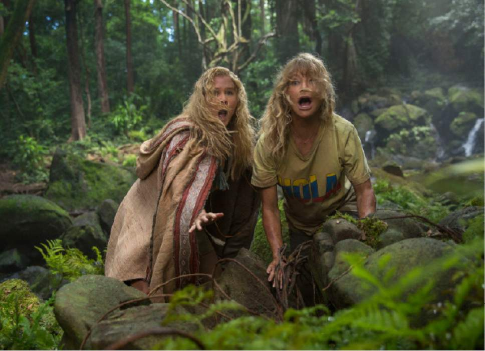 """This image released by 20th Century Fox shows Goldie Hawn, right, and Amy Schumer in a scene from """"Snatched."""" (Justina Mintz/20th Century Fox via AP)"""
