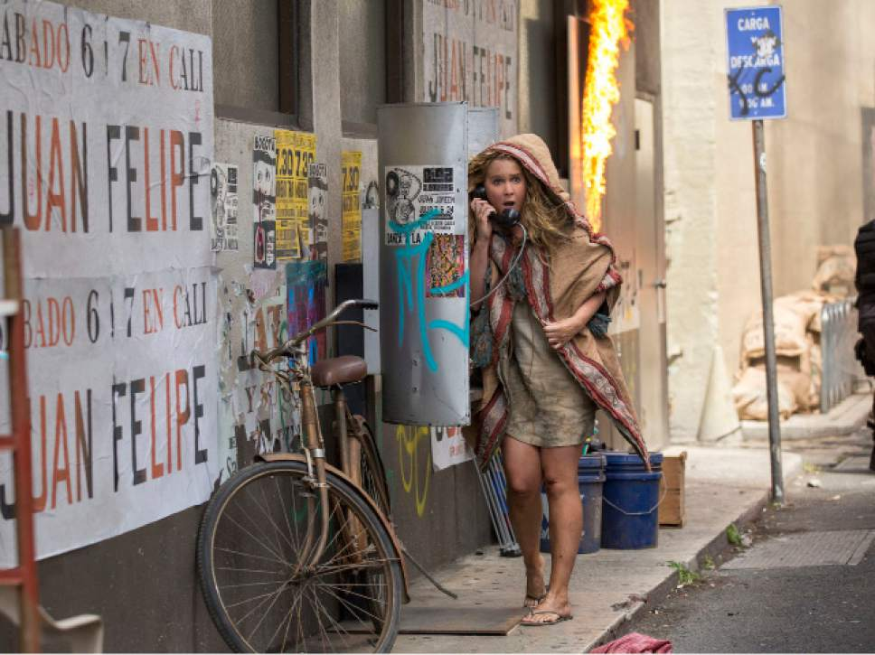 """This image released by 20th Century Fox shows Amy Schumer in a scene from """"Snatched."""" (Justina Mintz/20th Century Fox via AP)"""