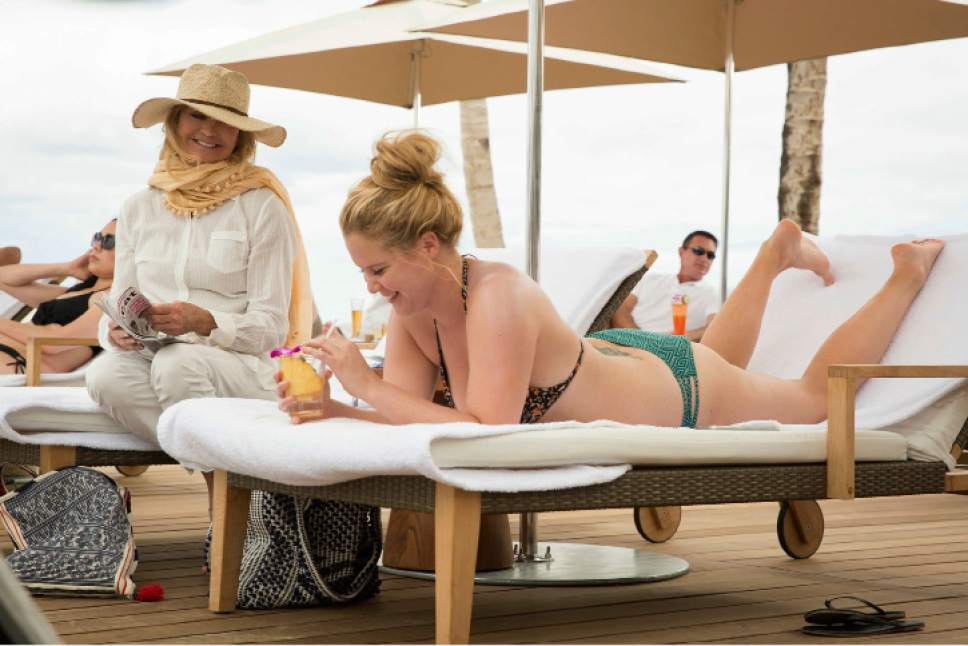 """This image released by 20th Century Fox shows Goldie Hawn, left, and Amy Schumer in a scene from """"Snatched."""" (Justina Mintz/20th Century Fox via AP)"""