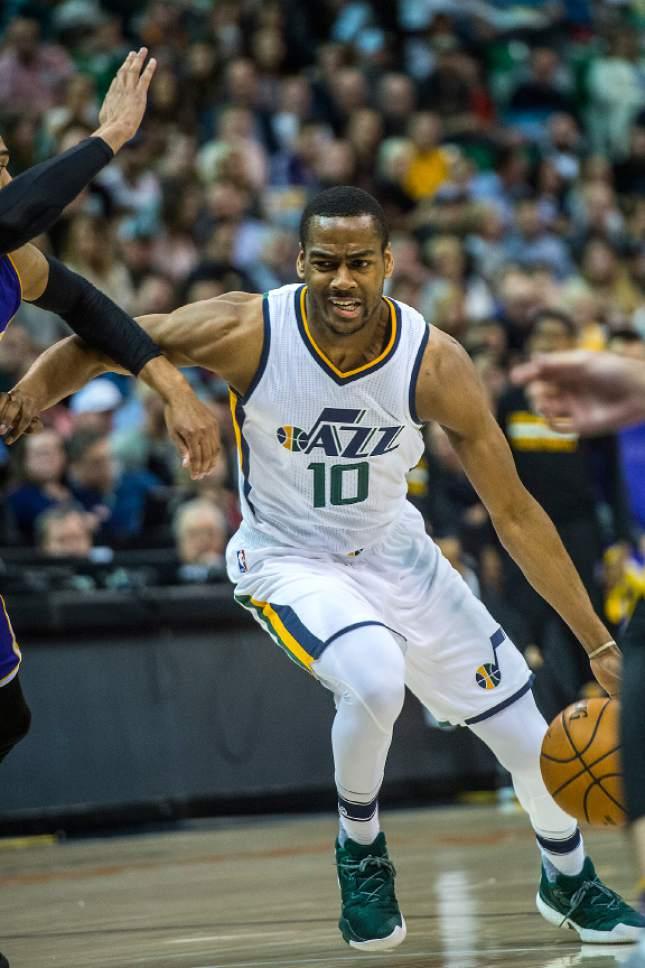 Chris Detrick  |  The Salt Lake Tribune Utah Jazz guard Alec Burks (10) runs past Los Angeles Lakers guard Jordan Clarkson (6) during the game at Vivint Smart Home Arena Thursday January 26, 2017.