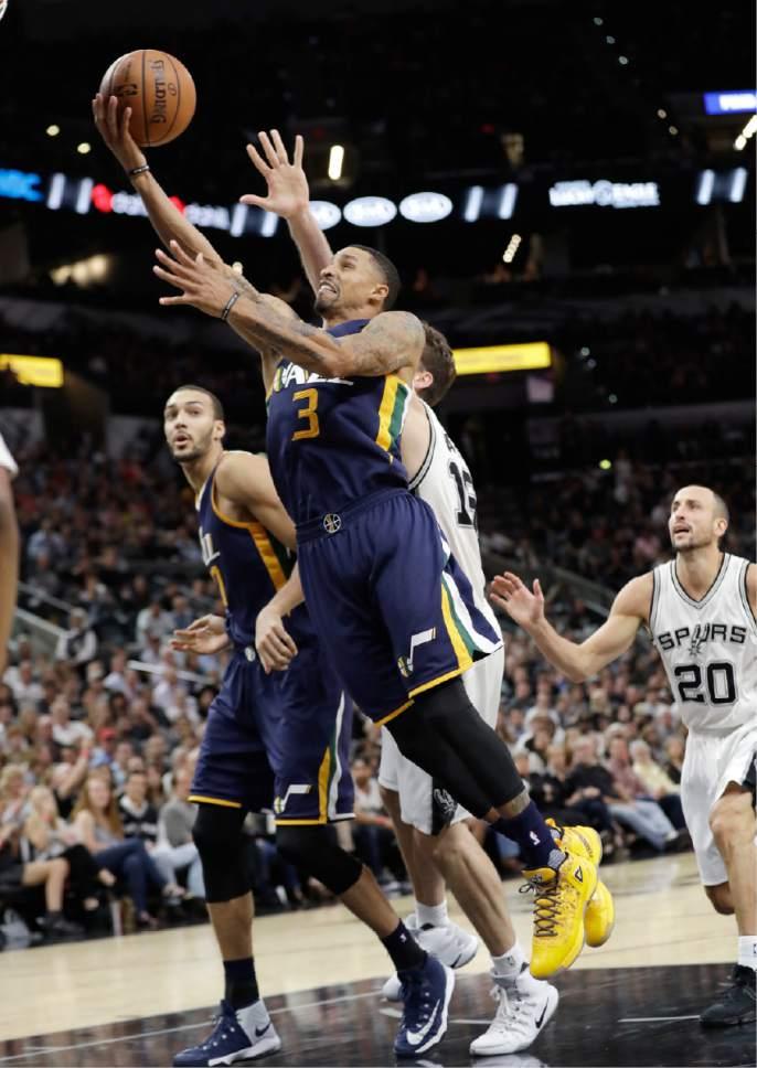 Utah Jazz guard George Hill (3) drives to the basket past San Antonio Spurs forward Pau Gasol (16) during the first half of an NBA basketball game, Tuesday, Nov. 1, 2016, in San Antonio. Utah won 106-91. (AP Photo/Eric Gay)