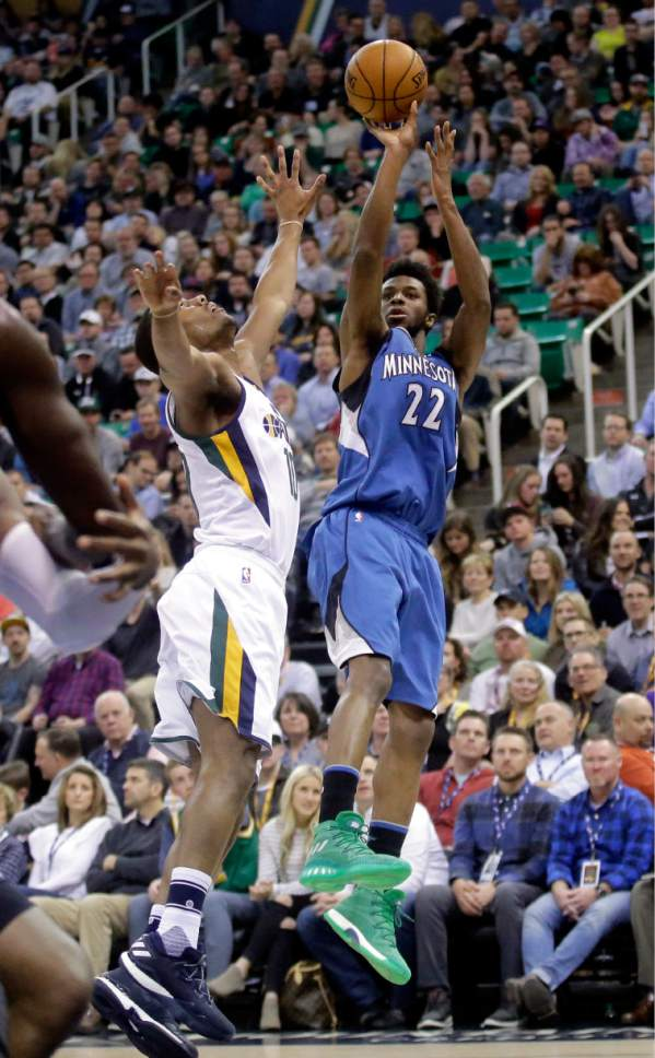 Minnesota Timberwolves forward Andrew Wiggins (22) shoots as Utah Jazz guard Alec Burks, left, defends during the first half in an NBA basketball game Wednesday, March 1, 2017, in Salt Lake City. (AP Photo/Rick Bowmer)