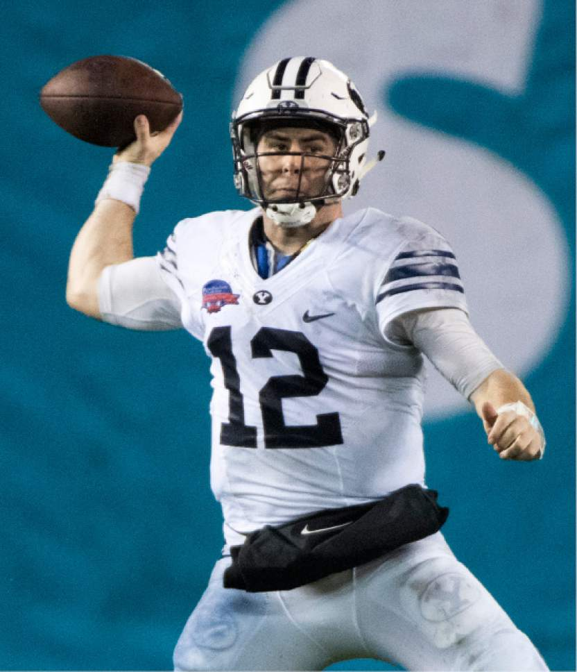 Rick Egan  |  The Salt Lake Tribune  Brigham Young quarterback Tanner Mangum (12) throws a pass for the Cougars, at BYU defeated Wyoming 24-21in the Poinsettia Bowl, at Qualcomm Stadium in San Diego, December 21, 2016.