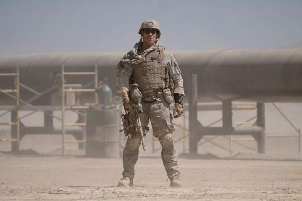 "This image released by Amazon Studios and Roadside Attractions shows John Cena in a scene from, ""The Wall."" (David James/Amazon Studios and Roadside Attractions via AP)"