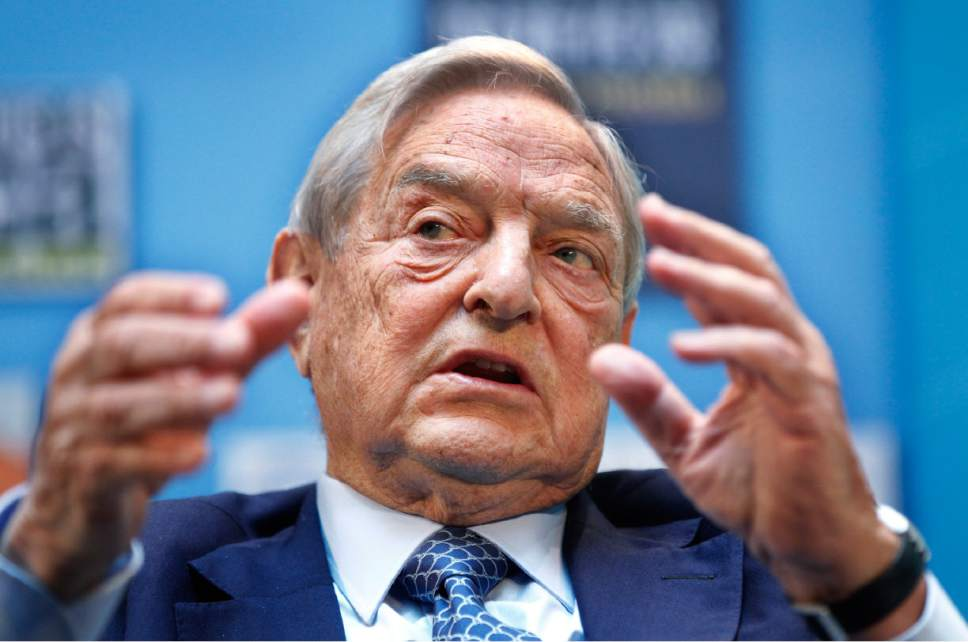 FILE - In this file photo dated Saturday, Sept. 24, 2011, chairman, Soros Fund Management, George Soros speaks during a forum at the IMF/World Bank annual meetings in Washington. The billionaire financier and philanthropist Soros says his fight against intolerance is rooted in his own experience of living through the Nazi occupation of Hungary, but some officials in Central Europe have accused him of using his money to force his liberal values on their nascent democratic societies. (AP Photo Manuel Balce Ceneta, FILE)
