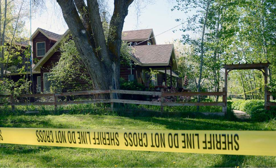 Al Hartmann  |  The Salt Lake Tribune Weber County sheriff's deputies investigate a homicide at a residential home in the 7400 East block of 400 South in Huntsville Thursday morning May 11.