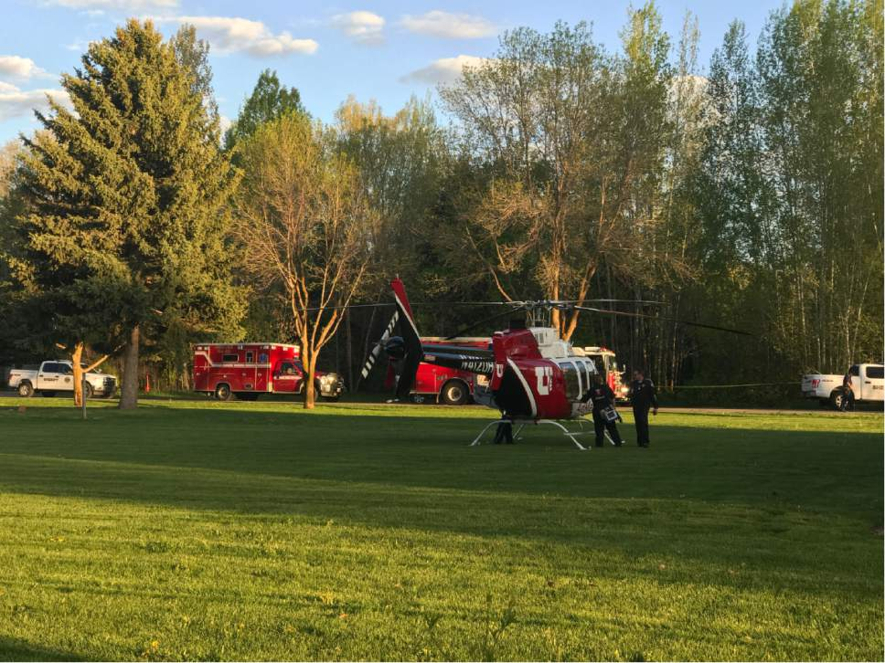 |  Courtesy Steve Woolley   A medical helicopter came to the scene of a homicide at a home in Huntsville on Wednesday, May 10, 2017. One man was dead at the scene and his wife was seriously injured, but expected to survive. Police have a suspect in custody.