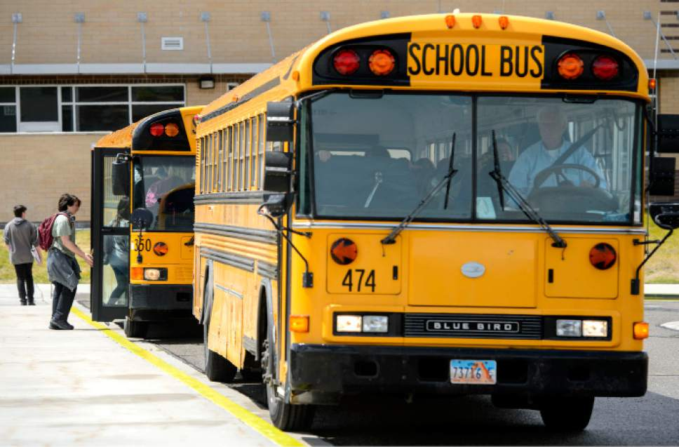 Steve Griffin     The Salt Lake Tribune   School busses leave Matheson Junior High School in Magna, Utah Tuesday May 16, 2017.