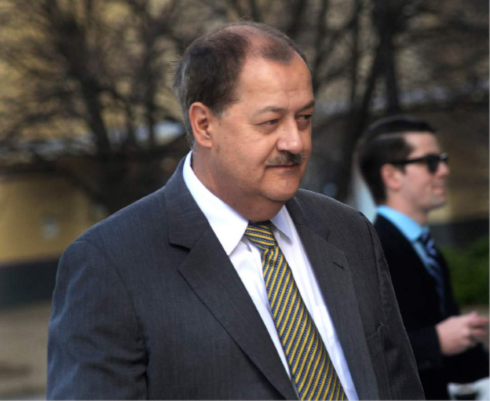 FILE - In a Wednesday, April 6, 2016, file photo, former Massey CEO Don Blankenship is escorted by Homeland Security officers from the Robert C. Byrd U.S. Courthouse in Charleston, W. Va. Blankenship has asked President Donald Trump to resist attempts in Congress to enhance criminal penalties for coal executives who violate mine safety and health standards. Blankenship, who recently was freed from federal prison, also asked the president in a letter Tuesday, May 16, 2017, to re-examine a federal investigation into the nation's worst coal mining disaster in four decades. (F. Brian Ferguson/Charleston Gazette-Mail via AP, File)
